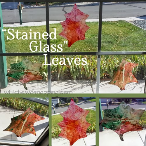 stained glass leaves on a window made from crayon and wax paper that are green, brown, and red.